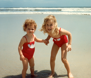 My sister Julie and I enjoying the beach as kids.